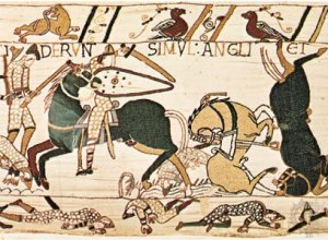 Bayeux Tapestry: English axman in combat with Norman cavalry [Credit: Giraudon/Art Resource, New York]