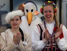 Emily Lemmon, left, and Julia Kulesza of Windsor's Polish Community along with Amherstburg's Department of Recreation and Culture bird mascot, centre, were part of Tourism Week Kick Off event hosted by Tourism Windsor Essex Pelee Island (TWEPI) and Windsor's Ontario Travel Information Centre Park Street East office Monday June 10, 2013. (NICK BRANCACCIO/The Windsor Star)